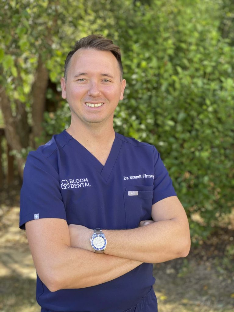 portrait of Dr Brandt Finney, a dentist at Bloom Dental in Bloomington Indiana
